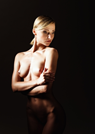 Dramatic nude shot of a sexy naked woman photo