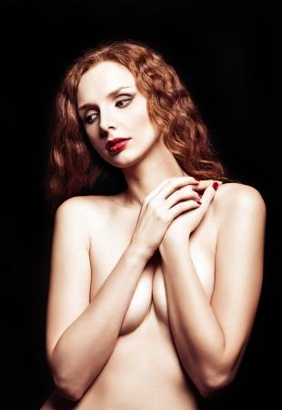 Dramatic retro portrait of a sexy redhead girl photo