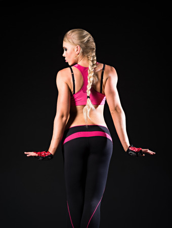 The athletic strong young woman  Rear view photo