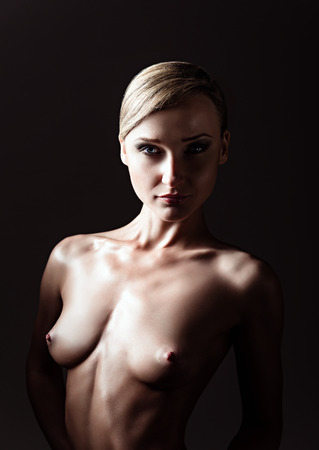Dramatic nude portrait of a sexy naked woman