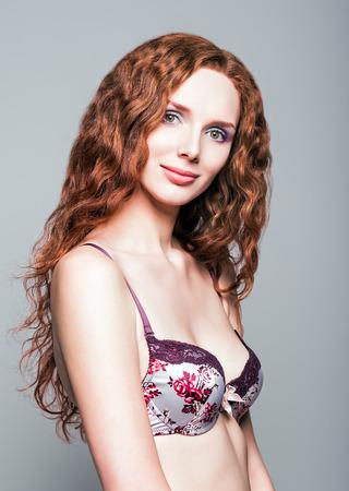 Studio portrait of a beautiful young redhead woman  photo
