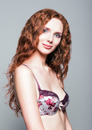red haired: Studio portrait of a beautiful young redhead woman  Stock Photo