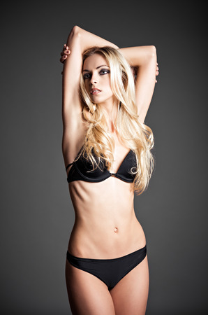 Studio fashion shot of a sexy blonde woman in underwear photo