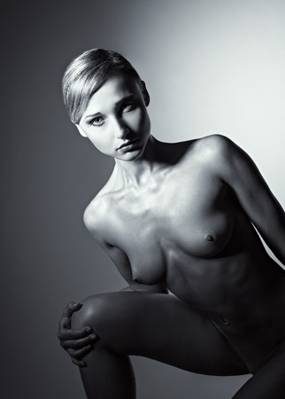 sexy nude blonde: Dramatic nude portrait of a sexy naked woman  Black and white