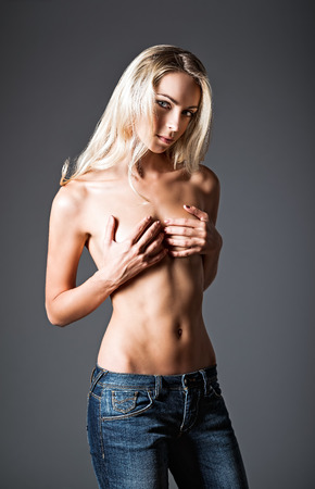 naked belly: Studio fashion portrait of a pretty young woman Stock Photo