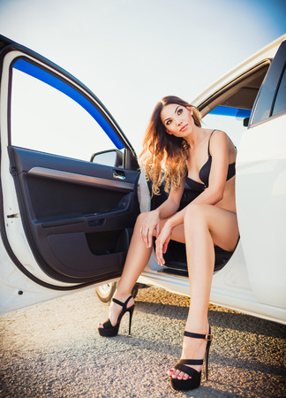 Lovely young woman sitting in a car photo