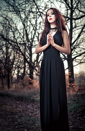 goth girl: Portrait of beautiful goth girl amongst the trees Stock Photo