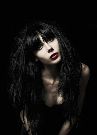goth girl: Portrait of a beautiful goth girl among the darkness Stock Photo