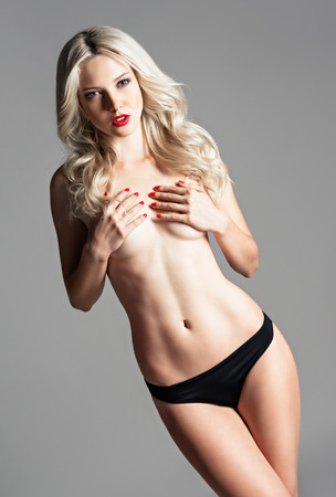 nude blond: Studio portrait of a sexy beautiful young woman