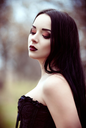 Closeup portrait of a beautiful young goth girl 写真素材