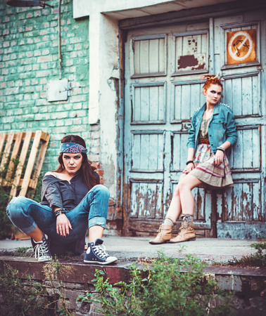 industrial ruins: Two beautiful grunge girls amongst industrial ruins Stock Photo