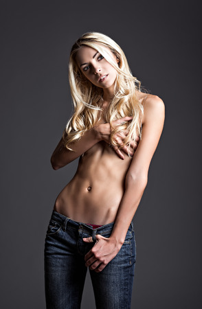 naked belly: Studio fashion portrait of a beautiful young girl