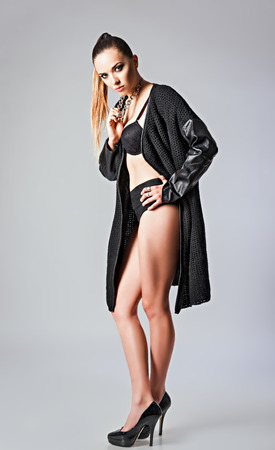 slender woman: Studio fashion shot: a sexy young girl wearing black sweater