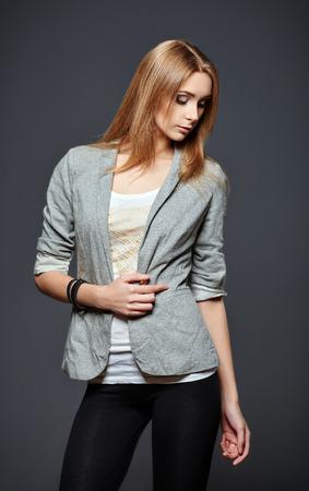 leggings: Studio fashion shot: a beautiful young woman in leggings, jacket and shirt