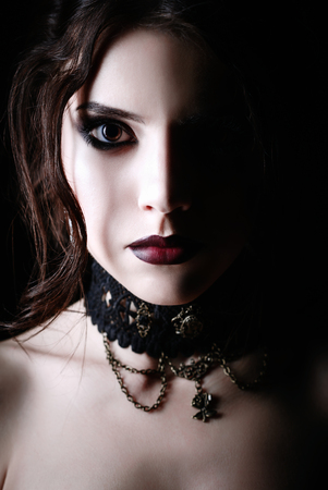 Closeup portrait of a beautiful young goth girl