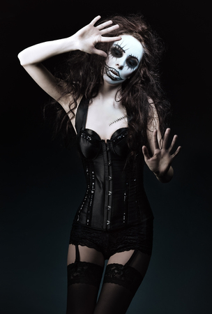 beautiful sad: Beautiful young woman in the image of a sad gothic freak clown