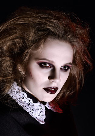 gothic girl: Horror shot: closeup portrait of a scary gothic girl Stock Photo