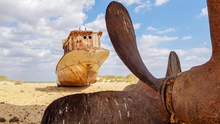 Old wreck of boat on the sand in Aral sea. Reklamní fotografie