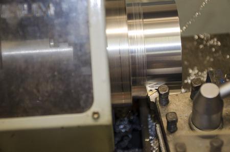 Detail of work at lathe with aluminium metal. Reklamní fotografie