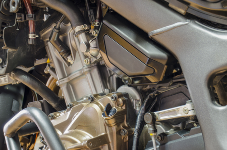 Detail of motorbike engine with crash bar and dismotled bonnet.