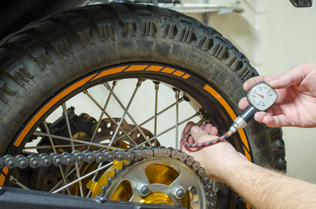 Control air pressure in motorcycle back tire.
