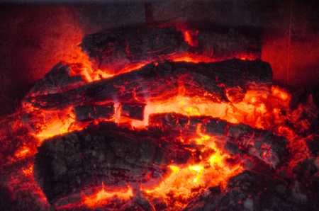 Ardent log and ash into home fireplace.