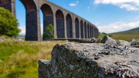 A blurred viaduct in England under clear sky with clouds. Reklamní fotografie