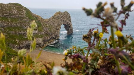 The bay with rock Durdle Door under fog and cold weather. Reklamní fotografie