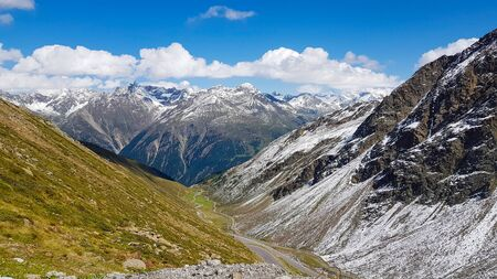 A view from road at first snow in Tirol Alps in September.