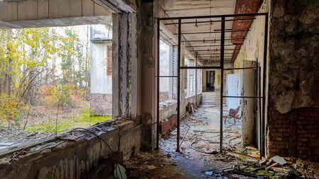 A interior of abandoned old building many years after nuclear powerplant explosion.