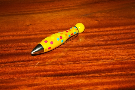 Yellow pen on the wooden floor   photo