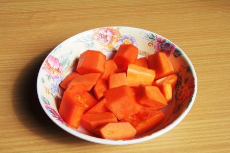 papaya flower: Papaya Ripe in bowl flower pattern  Stock Photo