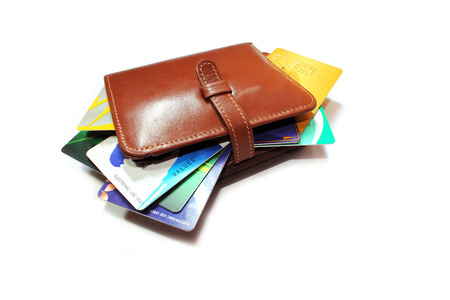 paper stack: Credit cards in wallet on a white background.