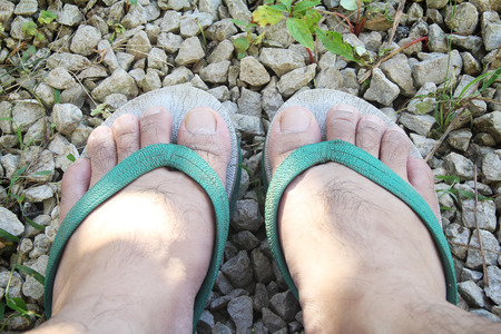 wearing sandals: feet of a man wearing Sandals Stock Photo