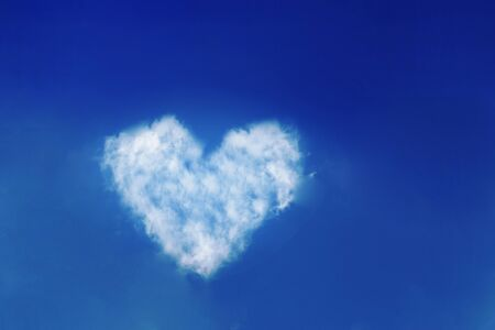 Heart shaped clouds in the blue sky.