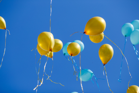 Floating balloons in the blue sky