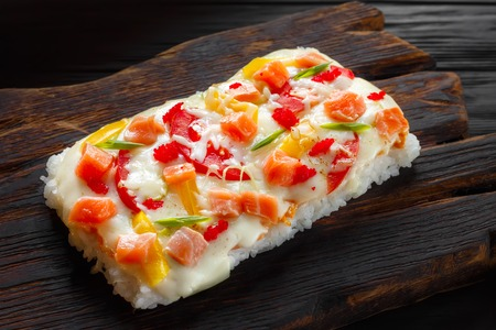 Piece of delicious japanese rice pizza with salmon served on rus Stok Fotoğraf - 100961129