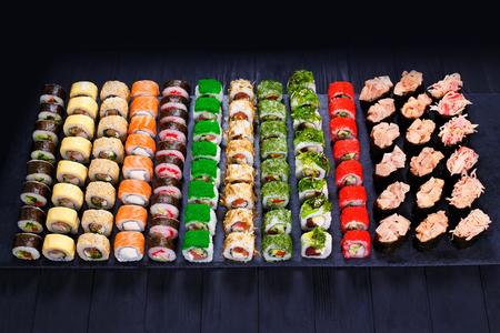 Great assortment of tasty multicolored maki sushi rolls. Sushi m Stock Photo