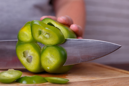 Dieting, healthy food. Hands slicing bell pepper, close up