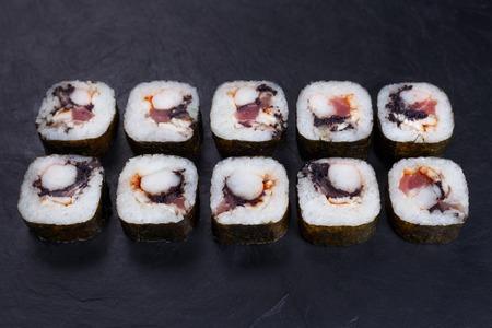 Japanese food, sushi restaurant. Delicious futomaki sushi rolls
