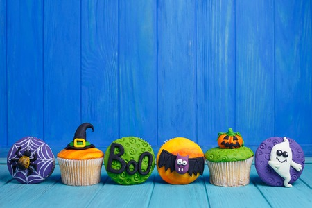 Delicious Halloween cupcakes set with bright decorations made of