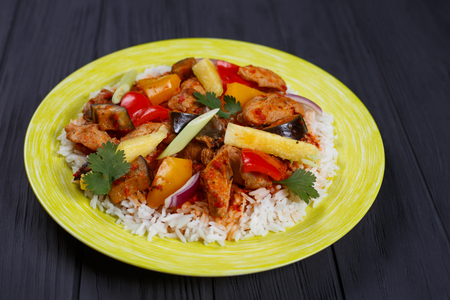 Delicious Pan-Asian food, appetizing spicy rice with chicken, pi