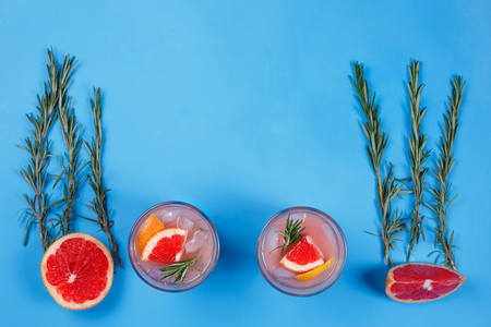 Grapefruit lemonade. Two glasses of refreshing drink, grapefruit