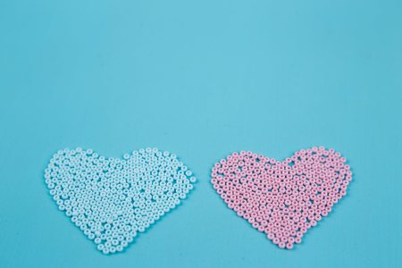 Pink and blue hearts of beads, copy space. Love, couple, boy and