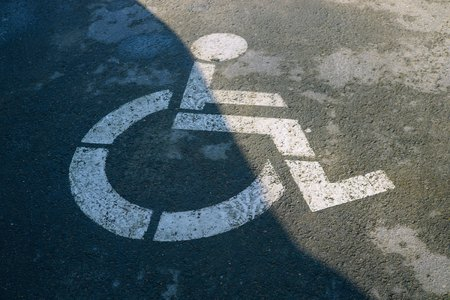 Handicap parking symbol on the road