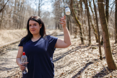 Overweight woman throw out slimming pills and start running outd