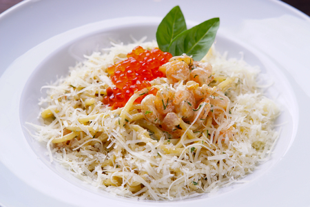 Seafood pasta with caviar and shrimps Stock Photo