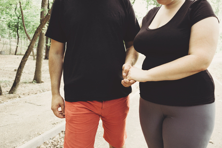 Overweight couple walking together in park 스톡 콘텐츠
