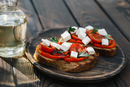 Homemade bruschetta with grilled tomatoes and feta
