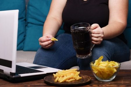 Mindless snacking, overeating, lack of physical activity Stok Fotoğraf - 112064117